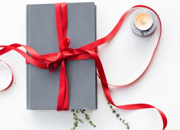 book gift with red ribbon